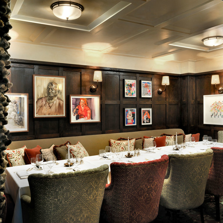 An intimate dining room with contemporary artwork
